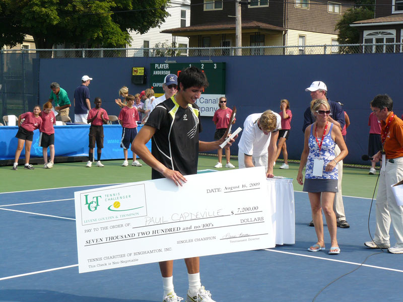 capdeville accepting a winning check